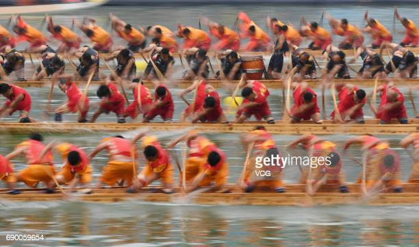 People compete during a dragon boat race on the Dragon Boat Festival on May 30 2017 in Tongren Guizhou Province of China More than 4200 contestants...