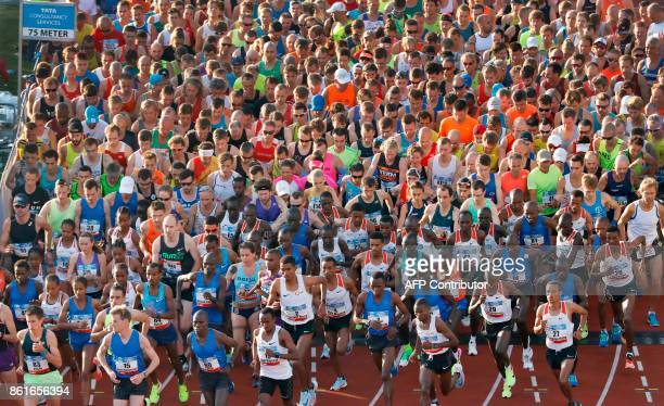TOPSHOT People compete in the Amsterdam Marathon in Amsterdam on October 15 2017 0509 setting a course record and taking one minute off his personnal...