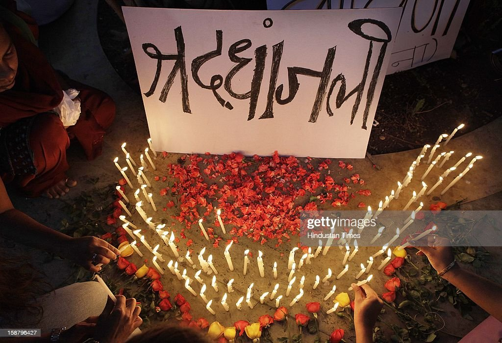 People condole by lighting candles for the death of Delhi rape case incident victim at Dadar on December 29, 2012 in Mumbai, India. The girl died of injuries in Singapore hospital after brutally gang raped in a moving bus on December 16, in Delhi.