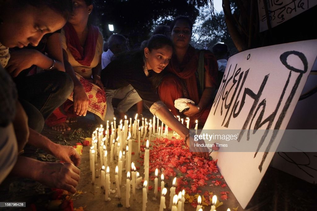 People condole by lighting candles for the death of Delhi rape case incident victim at Dadar on December 29, 2012 in Mumbai, India.The girl died of injuries in Singapore hospital after brutally gang raped in a moving bus on December 16, in Delhi.