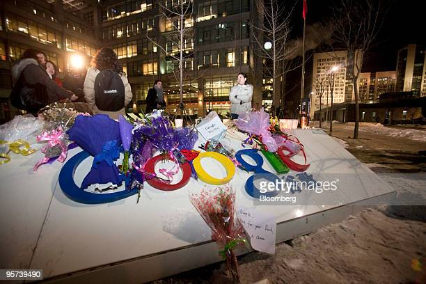 People congregate and take photographs at a makeshift tribute outside the Google Inc office in Beijing China on Wednesday Jan 13 2010 Google Inc...