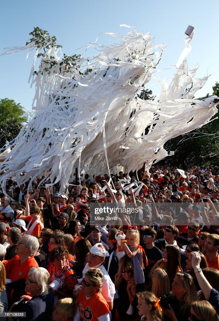 People congregate at the corner of College and Magnolia Streets during the Auburn Oaks at Toomer's Corner Celebration on April 20, 2013 in Auburn, Alabama.