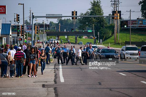 People continue to protest the death of an 18yearold Michael Brown in Ferguson United States on August 18 2014 Missouri Gov Jay Nixon ordered the...