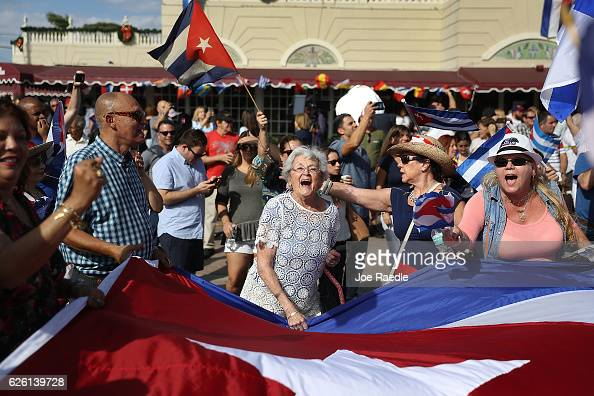 People continue to react to the news on Friday of the death of former Cuban President Fidel Castro as they gather outside the restaurant Versailles...