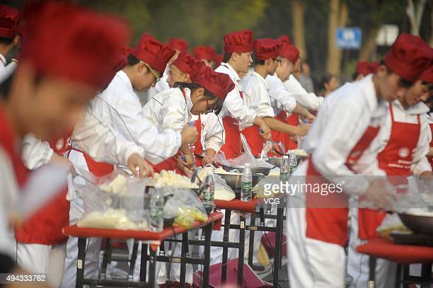 300 people cook fried rice to attempt a Guinness World Records for the 'Largest Fired Rice' on October 22 2015 in Yangzhou Jiangsu Province of China...