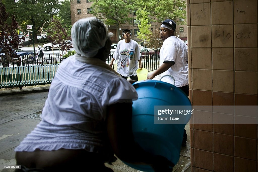 People cool off by splashing each other with water in a housing complex on July 6, 2010 in the Brooklyn borough of New York City. The National Weather Service has issued a heat advisory for parts of the Northeast, mid-Atlantic and parts of Michigan and Kentucky with temperatures in some areas predicted to reach 100 degrees.