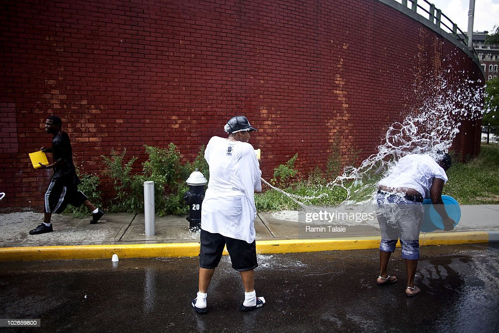 People cool off by splashing each other with water near an opened hydrant on July 6, 2010 in the Brooklyn borough of New York City. The National Weather Service has issued a heat advisory for parts of the Northeast, mid-Atlantic and parts of Michigan and Kentucky with temperatures in some areas predicted to reach 100 degrees.
