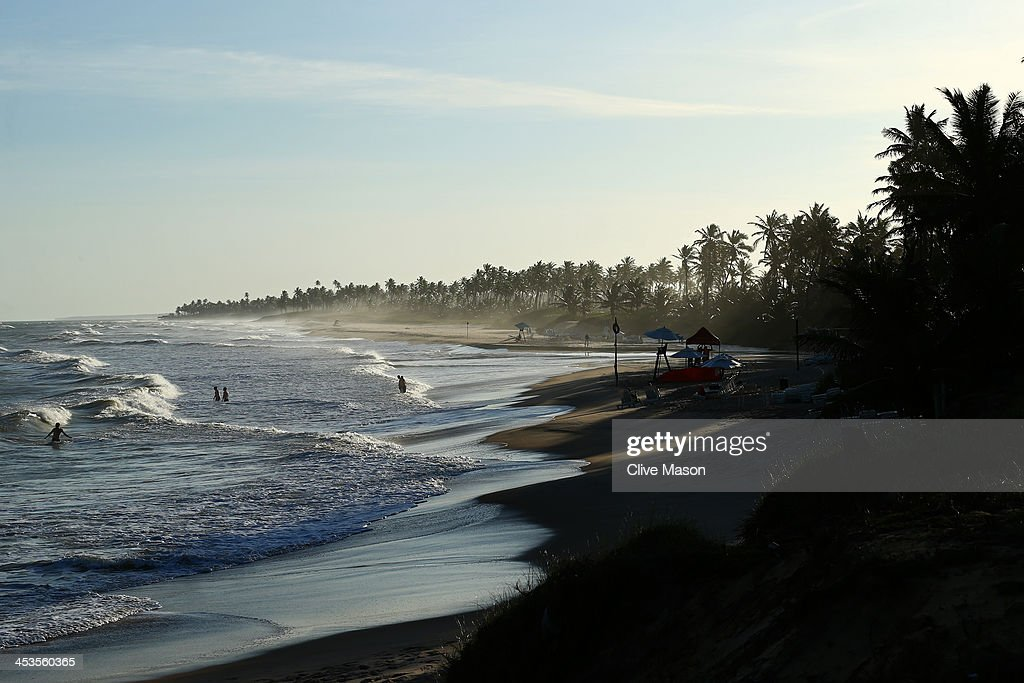 People cool off in the ocean at sunset ahead of the Final Draw for the 2014 FIFA World Cup at Costa do Sauipe Resort on December 4, 2013 in Costa do Sauipe, Brazil.