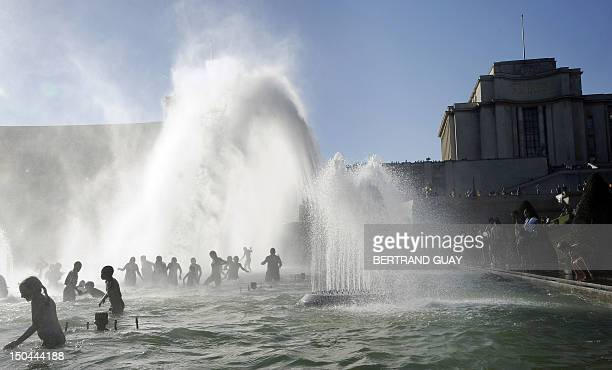 People cool off in the Trocadero's fountains on August 17 2012 in Paris as the city sweltered under a summer heatwave AFP PHOTO / BERTRAND GUAY