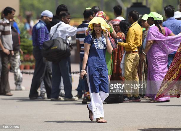 People cover themselves to protect against the hot summer day as the heat wave conditions prevailed in Northern India with the maximum temperature...