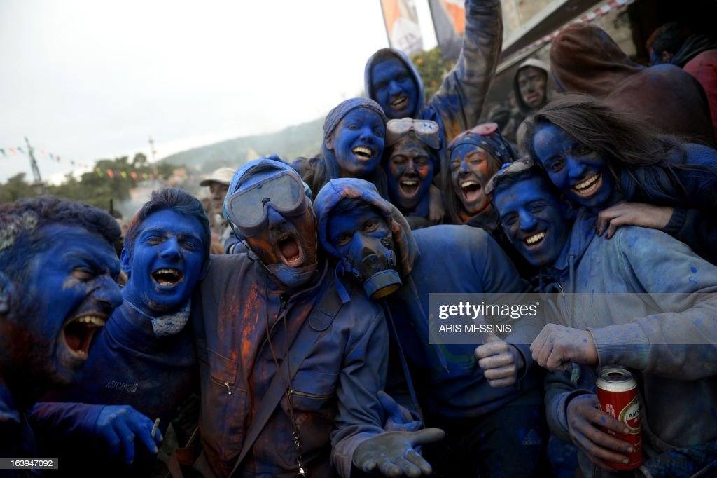 People covered with blue flour celebrate the annual custom of Flour War in Galaxidi, some 250kms south east of Athens on March 18, 2013.