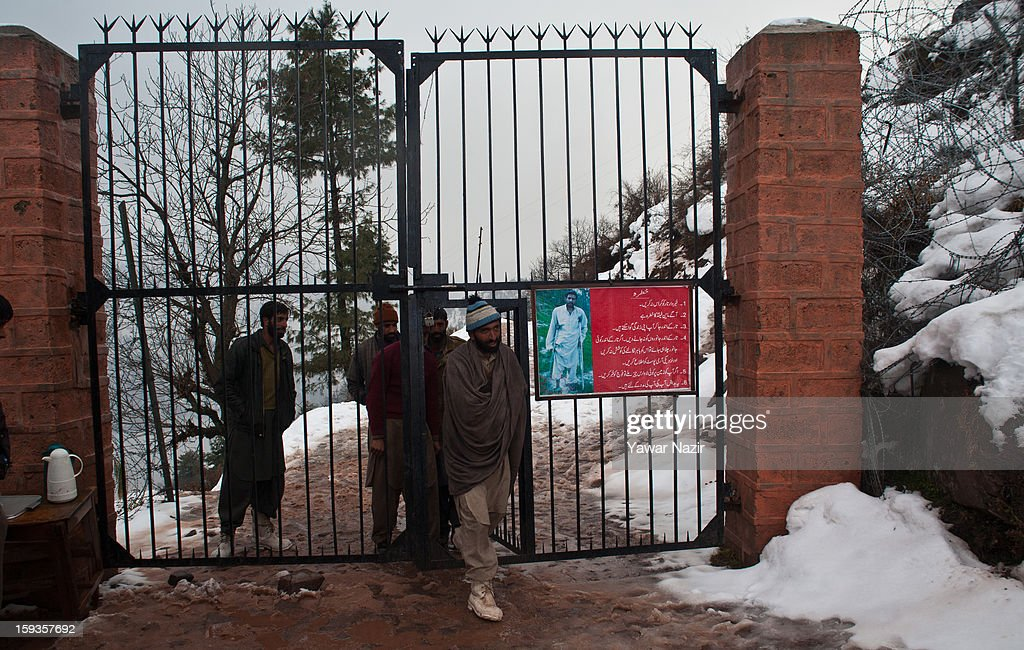 People cross a gate with a sign warning of a mine field ahead by Churunda village on January 12, 2013, northwest of Srinagar, the summer capital of Indian Administered Kashshmir, India. The village with a population of a little over 12,000 people has been bearing the brunt of cross-fire between nuclear rivals India and Pakistan. Last week a Pakistan solider was killed across the Line of Control (LOC), a military line that divides Indian-administered Kashmir from the Pakistan-administered Kashmir at this village. People living along the LoC have continually been at risk due to hostility between the armies of the two rival nations. Last year, in November, three people, including a pregnant woman, had died after a shell fired from Pakistan landed on one of the houses in the village. Tension between Pakistan and India has escalated after a fresh skimirish along the border. Both countries have summoned each other's envoy to protest against unacceptable and unprovoked' attacks.