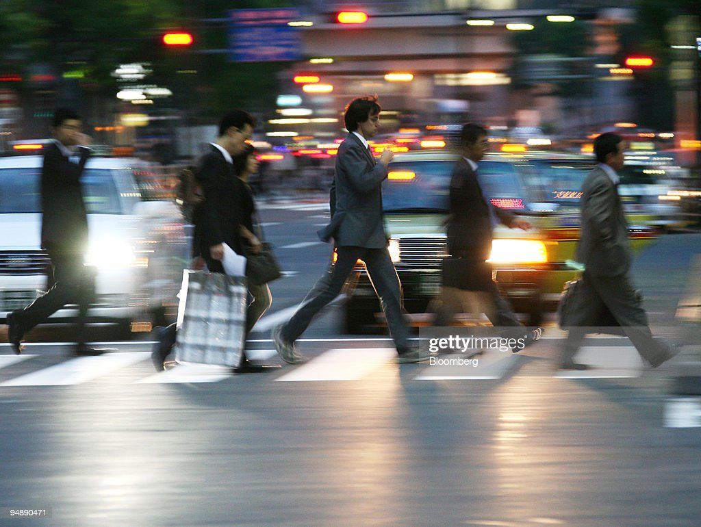 People cross an intersection in Tokyo Japan on Wednesday May 28 2008 Japan's unemployment rate was unchanged in May as higher energy costs eroded...