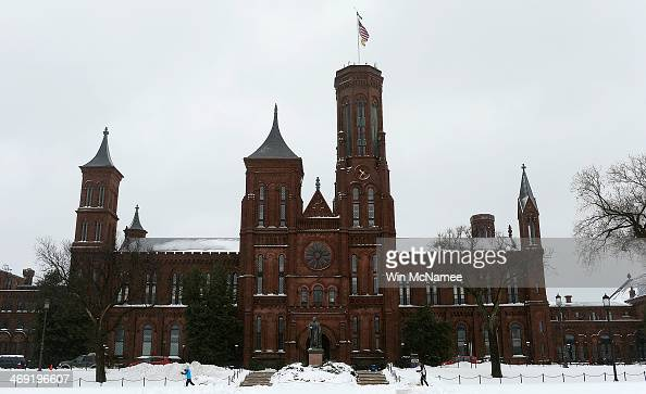People cross country ski in front of the Smithsonian building February 13 2014 in Washington DC The east coast of the US was hit with a winter storm...