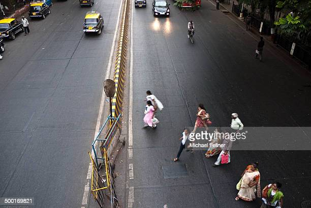 People crossing a street in Mumbai