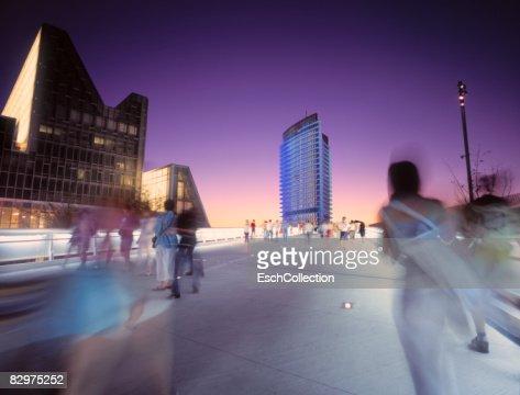 People crossing a walkway in Zaragoza, Spain