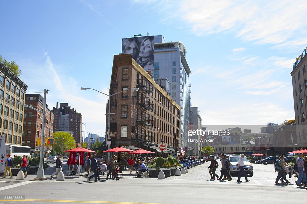 People crossing avenue near triangle building