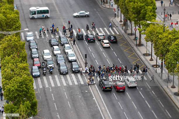 People crossing Champs Elysees from above view.