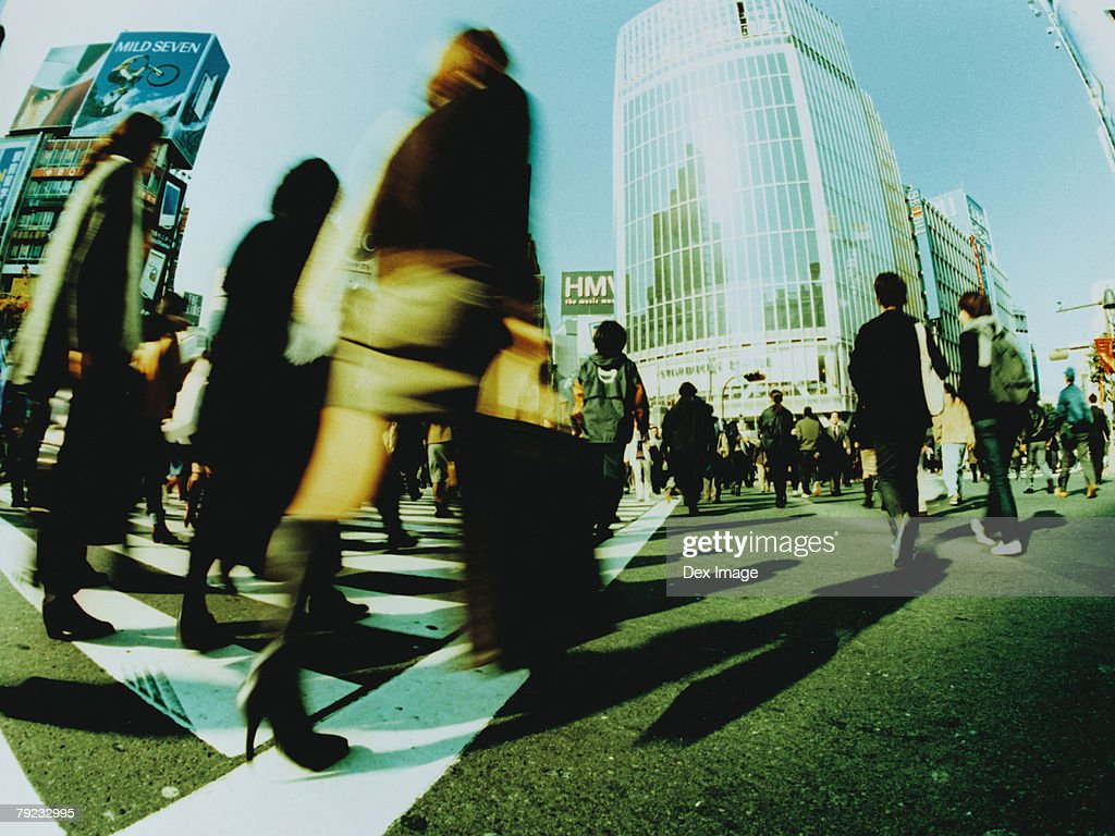 People crossing city street, Shibuya, Tokyo, Japan (blurred motion) : Stock Photo