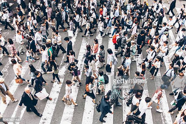 People crossing street on walkway