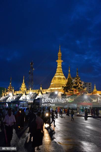 People crossing the road in front of the Sule Pagoda in Yangon.