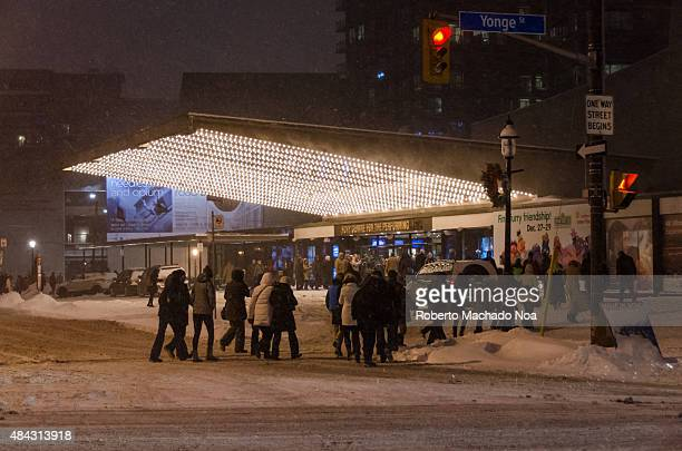 People crossing the Yonge street and moving towards the Sony Centre for the Performing Arts at night during winterIt is Canadas largest softseat...