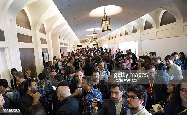 People crowd an entrance at Bill Graham Civic Auditorium before the start of an Apple event in San Francisco California on September 7 2016 Apple on...
