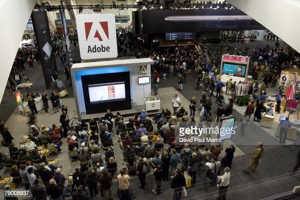 People crowd around an Adobe presentation at the Moscone Center at the 2008 Macworld at the Moscone Center January 15 2008 in San Francisco...