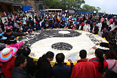 People crowd around the huge round tofu with a Tai Chi pattern at a square in Laojun Mountain on May 22 2016 in Luoyang Henan Province of China...