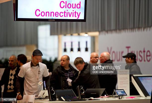 People crowd at the Deutsche Telekom cloud computing exhibition prior to the opening of the CeBIT IT fair on March 5 2012 in Hanover central Germany...