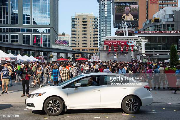 People crowd in Dundas Square the streets during Canada Day Canada Day is celebrated annually and is a national holiday
