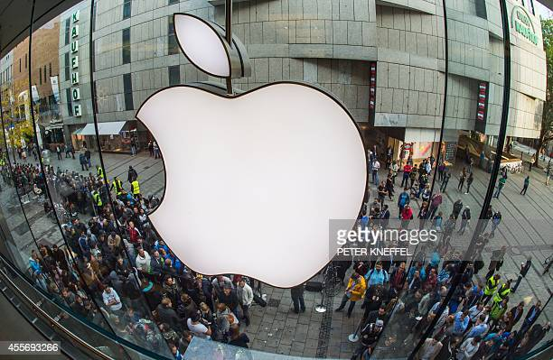 People crowd in front of the Apple Store in Munich southern Germany on September 19 2014 to purchase a new Apple Iphone 6 mobile device Apple said...