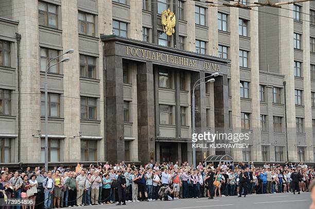 People crowd in front of the State Duma in central Moscow on July 18 protesting as opposition leader Alexei Navalny was sentenced to five years in a...