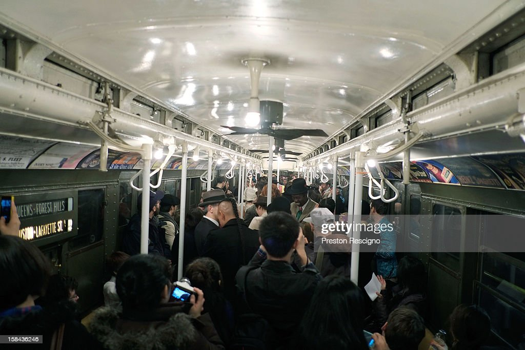 People crowd into a vintage New York City subway car as people dance to a live band on December 16, 2012 in New York City. The New York Metropolitan Transportation Authority (MTA) runs vintage subway trains from the 1930's-1970's each Sunday along the M train route from Manhattan to Queens through the first of the year.