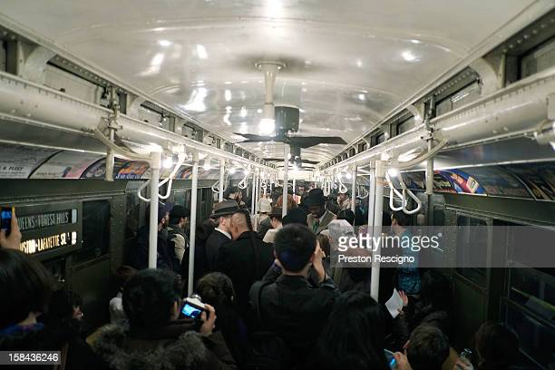People crowd into a vintage New York City subway car as people dance to a live band on December 16 2012 in New York City The New York Metropolitan...