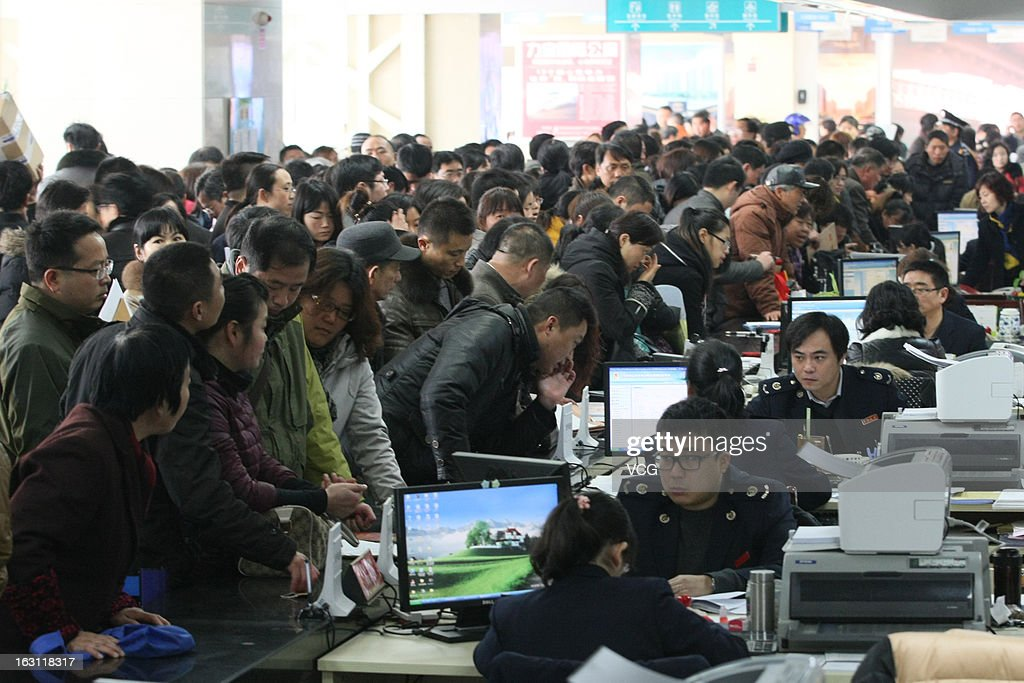 People crowd into the Nanjing Municipal Real Estate Trading Centre looking to sell property ahead of a tax policy change on March 4, 2013 in Nanjing, China. According to an online statement from the China's State Council last Friday, China will rise the capital gains tax on home sales, potentially levying sellers with a tax as high as 20 percent a signifucant increase on the current 1 percent to 2 percent. Excessive real estate speculation and a 'housing bubble' is seen as risk to the nation's overall economic stability.