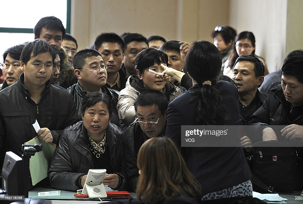 People crowd into the Nanjing Municipal Real Estate Trading Centre to sell their second-hand houses before a tax policy change on March 4, 2013 in Nanjing, China. According to an online statement from the China's State Council last Friday, China will rise the capital gains tax on home sales, potentially levying sellers with a tax as high as 20 percent a signifucant increase on the current 1 percent to 2 percent. Excessive real estate speculation and a 'housing bubble' is seen as risk to the nation's overall economic stability.
