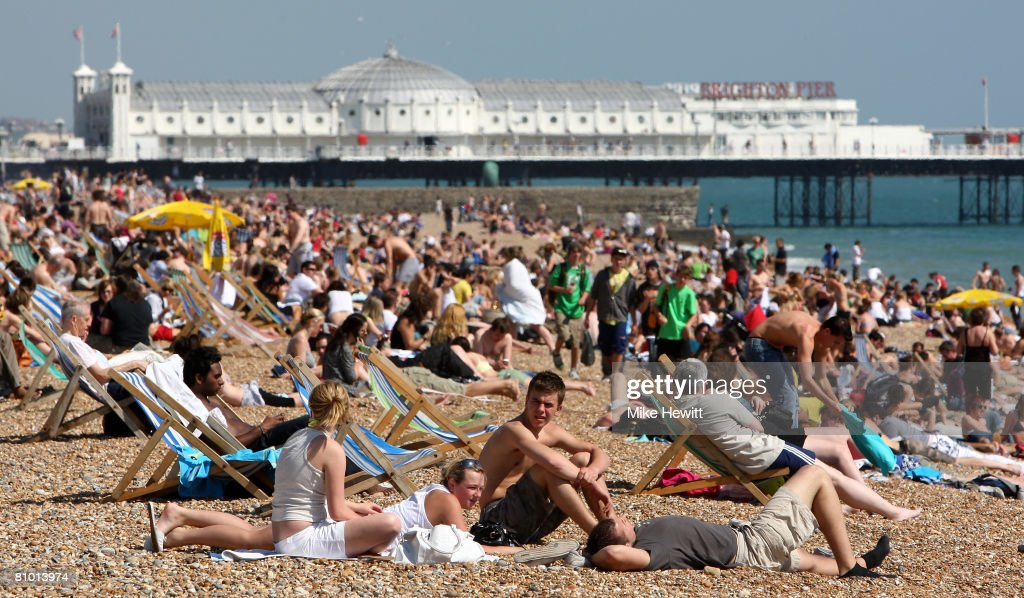 People crowd on to Brighton beach to enjoy the warm weather on May 7, 2008 in Brighton, England.
