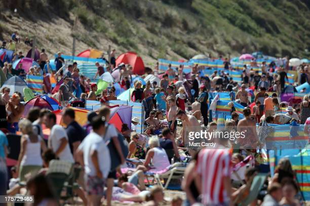 People crowd onto the beach as the projuniors heat of the Boardmasters prosurfing competition takes place on Fistral Beach on August 7 2013 in...