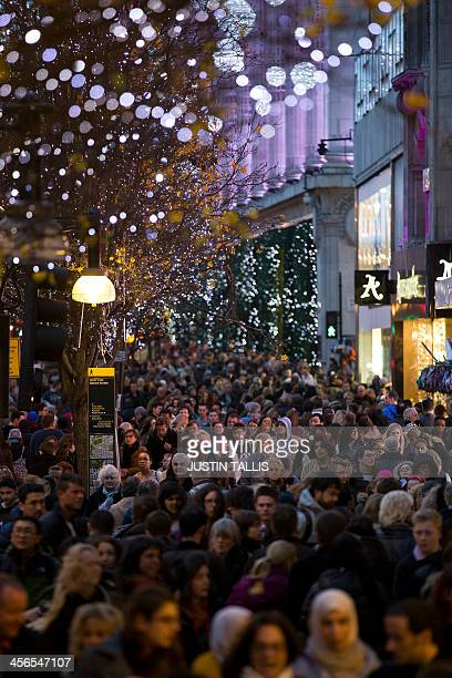 People crowd Oxford Street one the main shopping streets in central London on December 14 with only two weekends to go until Christmas AFP...