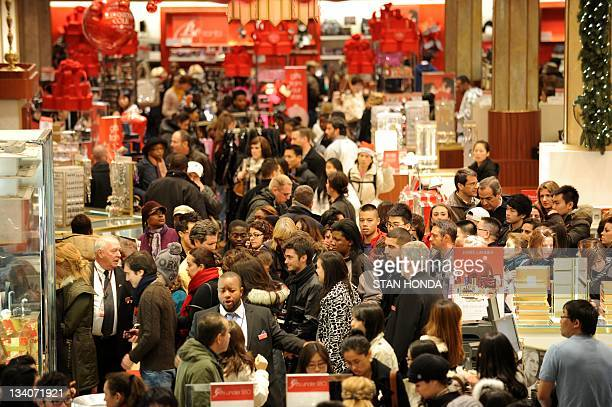 People crowd the aisles inside Macy's department store November 25 2011 in New York after the midnight opening to begin the 'Black Friday' shopping...