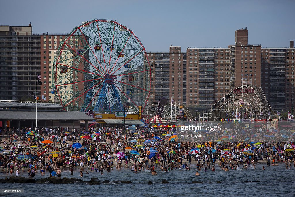 People crowd the beach at Coney Island on Memorial Day May 26, 2014 in the Brooklyn borough of New York City. Memorial Day, originally celebrated as Decoration Day after the Civil War in 1868, became a federal holiday in 1971 and commemorates those who have died fighting for the U.S. in wars.