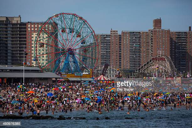 People crowd the beach at Coney Island on Memorial Day May 26 2014 in the Brooklyn borough of New York City Memorial Day originally celebrated as...