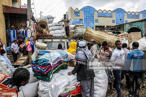People crowd the market streets of Merkato district on July 04 2014 in Addis Ababa Ethiopia The Ethiopian government has recently launched a new...