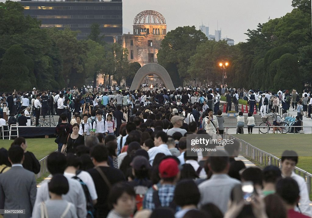 People crowd the Peace Memorial Park in Hiroshima on May 27, 2016, after a visit there by U.S. President Barack Obama earlier that day. The Atomic Bomb Dome can be seen in the background.