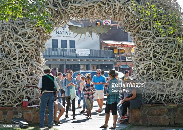 People crowd the side walks in the main Square on August 20 2017 in Jackson Wyoming People are flocking to the Jackson and Teton National Park area...