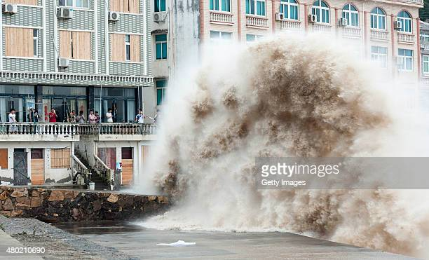 People crowd to look sea waves at Shitang Town on July 10 2015 in Wenling Zhejiang Province of China News from Zhejiang Meteorologic Bureau that...