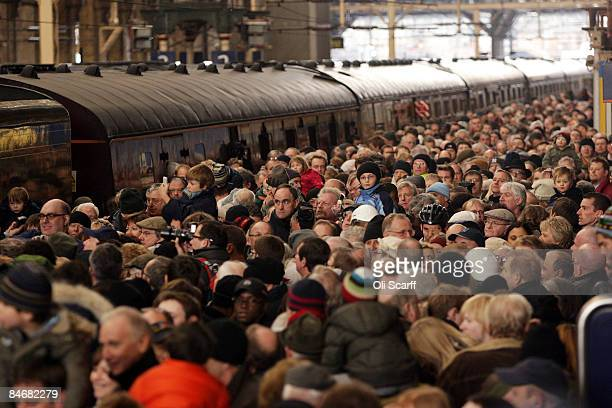 People crowd to see The Talisman the first new mainline steam locomotive to be built in Britain for almost 50 years as it enters London's Kings Cross...