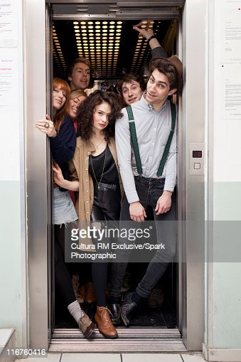 People crowding into elevator