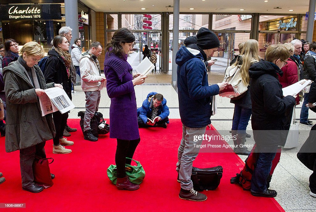 People cue in front of a ticket office for the 63rd Berlinale International Film Festival on February 4, 2013 in Berlin, Germany. The 2013 Berlinale will run from February 7-17, 2013